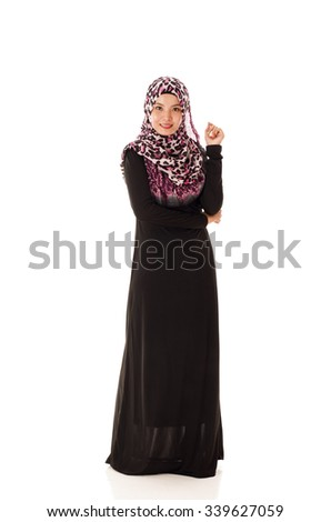 Beautiful Young Muslimah fashion pose isolated on white background - stock photo