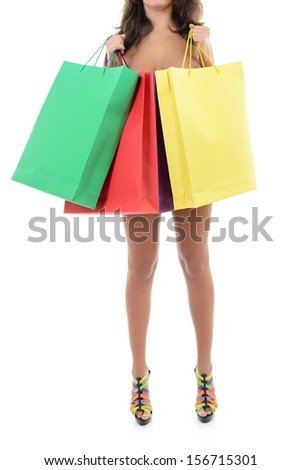 Beautiful young naked woman holding shopping bags, over white background - stock photo