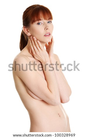 Beautiful young naked woman isolated on white background