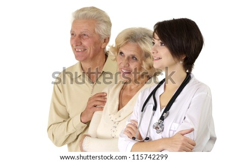 Beautiful young nice nurse with elderly on a light background - stock photo
