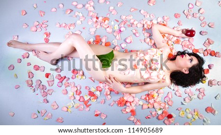 beautiful young nude woman with roses representing beauty - stock photo