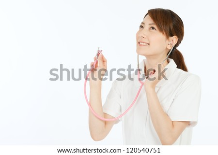 Beautiful young nurse on white background