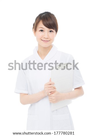 Beautiful young nurse on white background  - stock photo