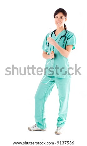 Beautiful young nurse preparing a drip infusion - stock photo