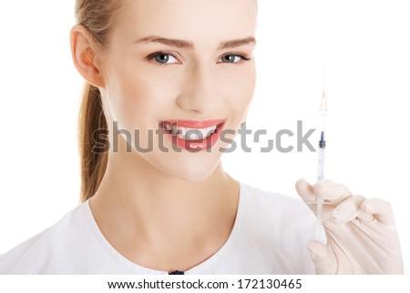 Beautiful young nurse with needle. Isolated on white. - stock photo