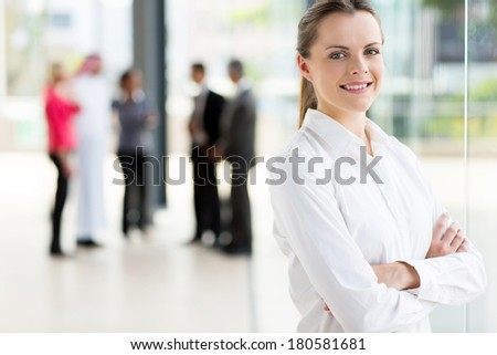 beautiful young office worker looking at the camera - stock photo