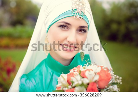 Beautiful young oriental bride preparing for wedding - stock photo