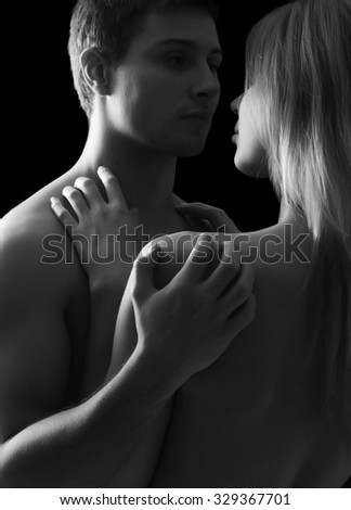 Beautiful young pair on a black  background - stock photo