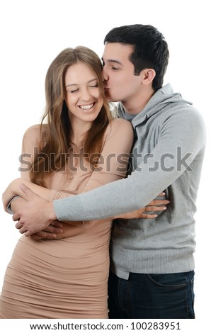 Beautiful young pair on the white background - stock photo