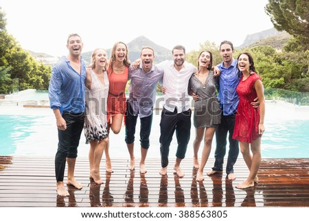 Beautiful young people having fun near swimming pool - stock photo