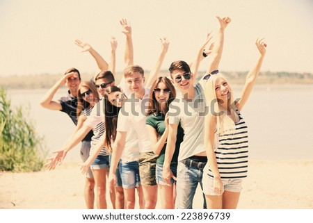 Beautiful young people on beach - stock photo