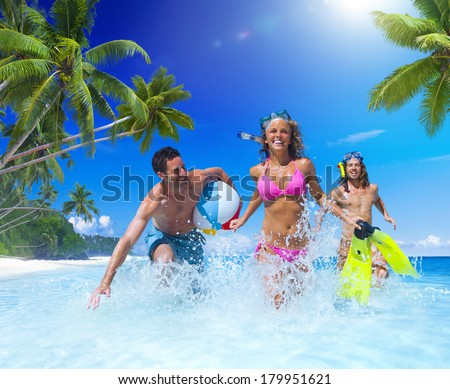 Beautiful Young People Playing at Tropical Beach - stock photo