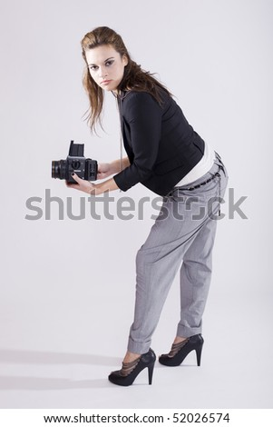 beautiful young photographer with a medium format fillm camera - stock photo