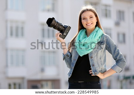Beautiful young photography take photos outdoors on city street - stock photo