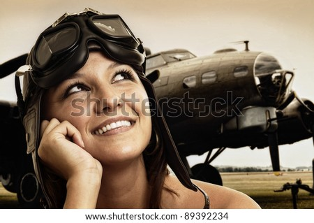 Beautiful young pilot hat and goggles - stock photo