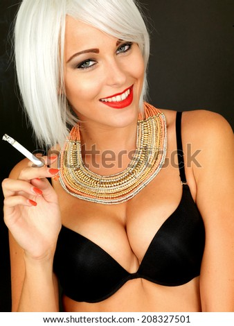 Beautiful Young Pin Up Model Smoking - stock photo