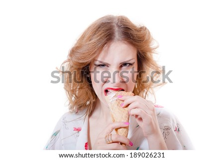 Beautiful young pinup woman eating ice cream cone looking in camera isolated on white background closeup portrait - stock photo