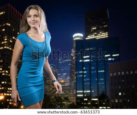 Beautiful young posing over night city background - stock photo