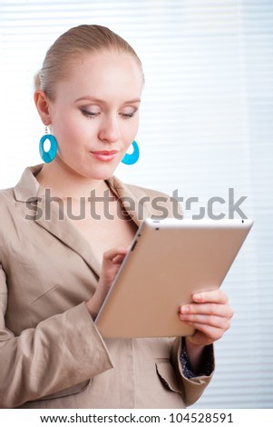 beautiful young positive business woman/student using a tablet o - stock photo
