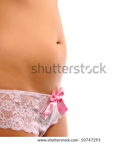 Beautiful young pregnat woman showing her belly in the first trimester (twelve weeks) isolated in cute lingerie. - stock photo