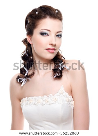 Beautiful young pretty bride with wedding hairstyle - close-up - stock photo