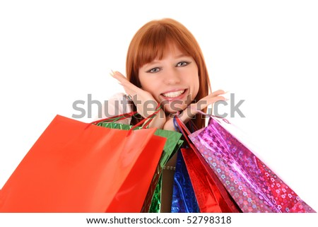 Beautiful, young, redhair woman with color  shopping bags in her hand.  Isolated on white background. - stock photo