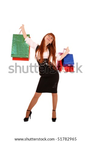 Beautiful, young, redhead woman with color shopping bags in her hand. Isolated on white background. - stock photo