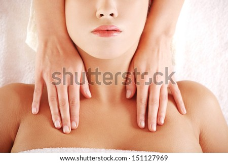 Beautiful young relaxed woman enjoy receiving massage at spa saloon  - stock photo