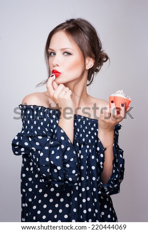 beautiful young retro pinup woman eat sweet cake food isolated on white iin studio - stock photo
