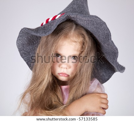 Beautiful young sad girl in cap - stock photo