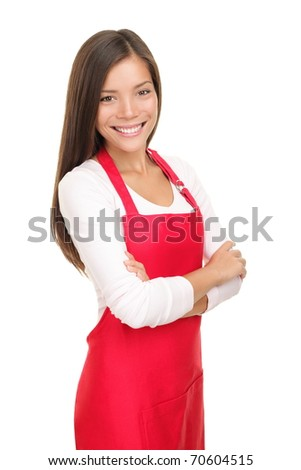 Beautiful young sales clerk or small shop owner isolated on white background. Smiling young woman. - stock photo