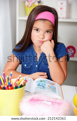 Beautiful young school girl is sick of learning - stock photo