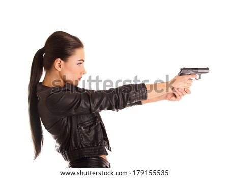 beautiful young secret agent pointing a gun - stock photo