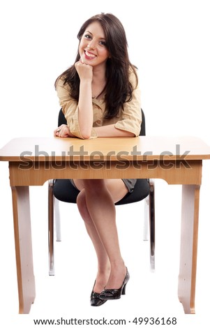 Beautiful young secretary or businesswoman at desk