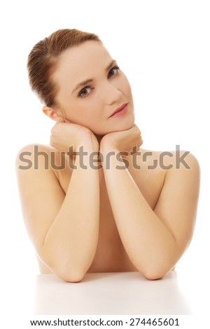 Beautiful young sensual spa woman by a desk. - stock photo