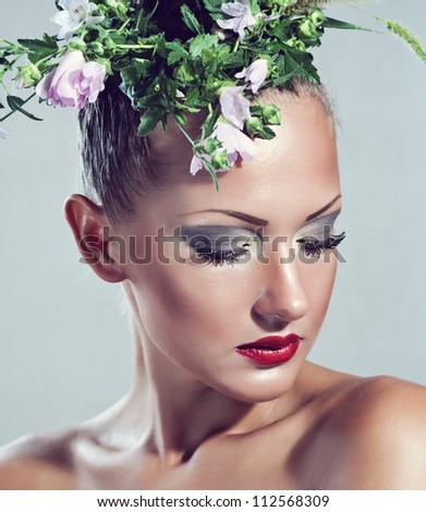 beautiful young sensual woman  with flowers