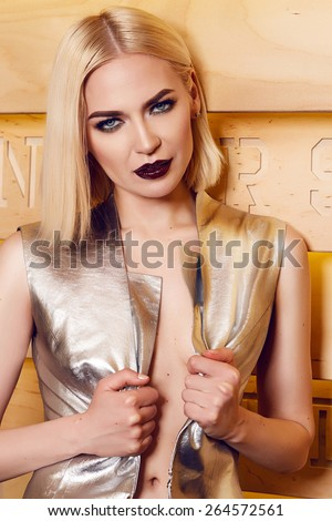Beautiful young sexy blonde attractive woman with a hairstyle and bright evening make-up dressed in stylish fashion designer clothes Cocktail plpte high heels at the party have fun drink cocktail  - stock photo