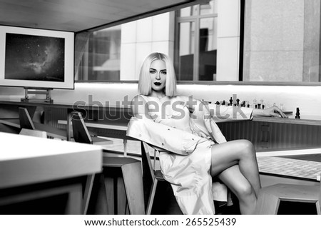 Beautiful young sexy blonde attractive woman with a hairstyle and bright evening make-up dressed in stylish fashion designer clothes Cocktail dress high heels at the party have fun drink cocktail. - stock photo