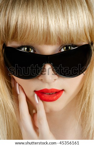 Beautiful young sexy blonde woman in black sunglasses closeup portrait - stock photo