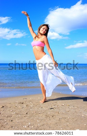 Beautiful young sexy Brazilian model by the sea - stock photo