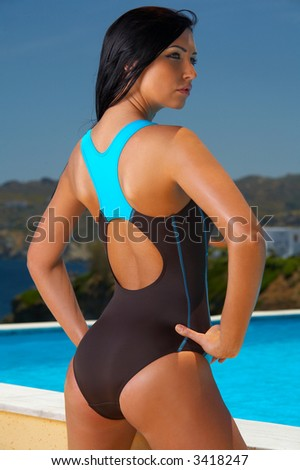 Beautiful young Sexy brunette woman posing in swimming wear