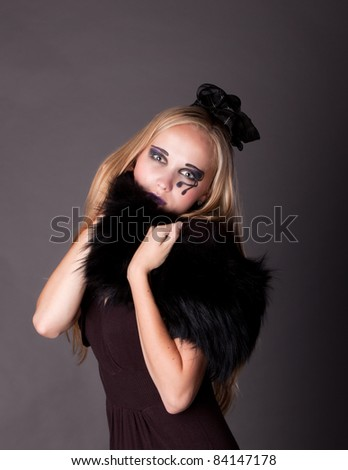 beautiful young sexy girl make up as a witch for Halloween,  halloween party, halloween costume, halloween witch, woman Halloween, scary halloween, spooky halloween image, woman witch - stock photo