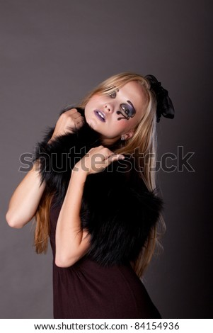 beautiful young sexy girl make up as a witch for Halloween is looking straight,  halloween party, halloween costume, halloween witch, woman Halloween, scary halloween, spooky halloween image, vampire - stock photo