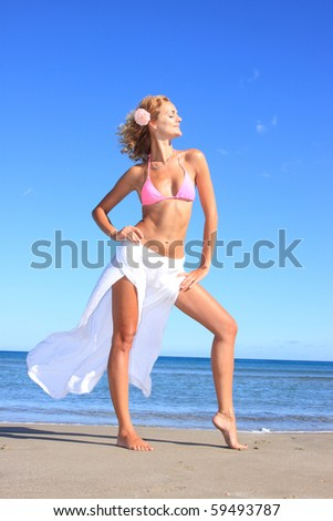 Beautiful young sexy model by the sea - stock photo