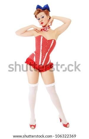 Beautiful young sexy pin-up girl in polka dot corset, on white background - stock photo