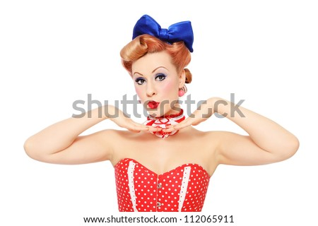 Beautiful young sexy pin-up promo girl in polka dot corset on white background