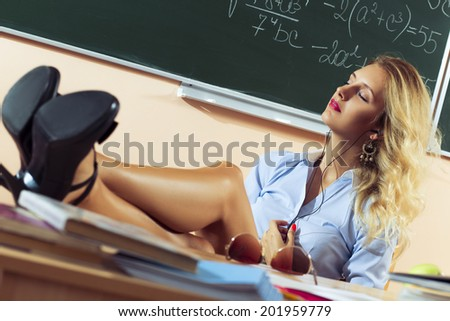 Beautiful young sexy teacher resting between the classes