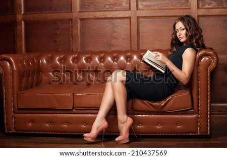 beautiful young sexy woman holding a book in his hands - stock photo