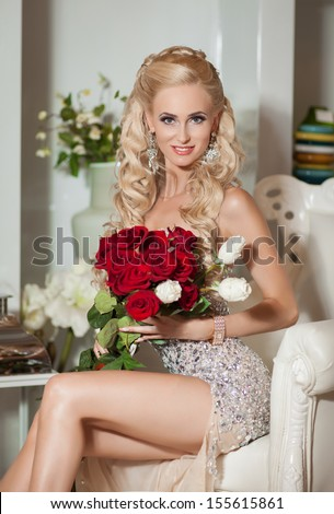 Beautiful young sexy woman in luxurious restaurant interior. Luxury lifestyle. Joy. Elation. Vintage vogue style. pretty young woman in cafe Happy smiling/ luxurious blonde rich lady at retro hotel