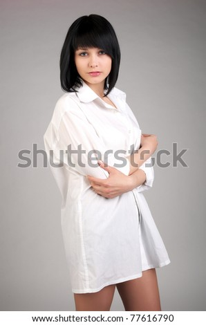 Beautiful young sexy woman in mens shirt - stock photo